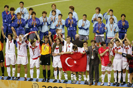TURKEY SOCCER TEAM CELEBRATE THIRD PLACE WIN AGAINST SOUTH KOREA AT WORLD CUP PLAY-OFF MATCH IN TAEGU
