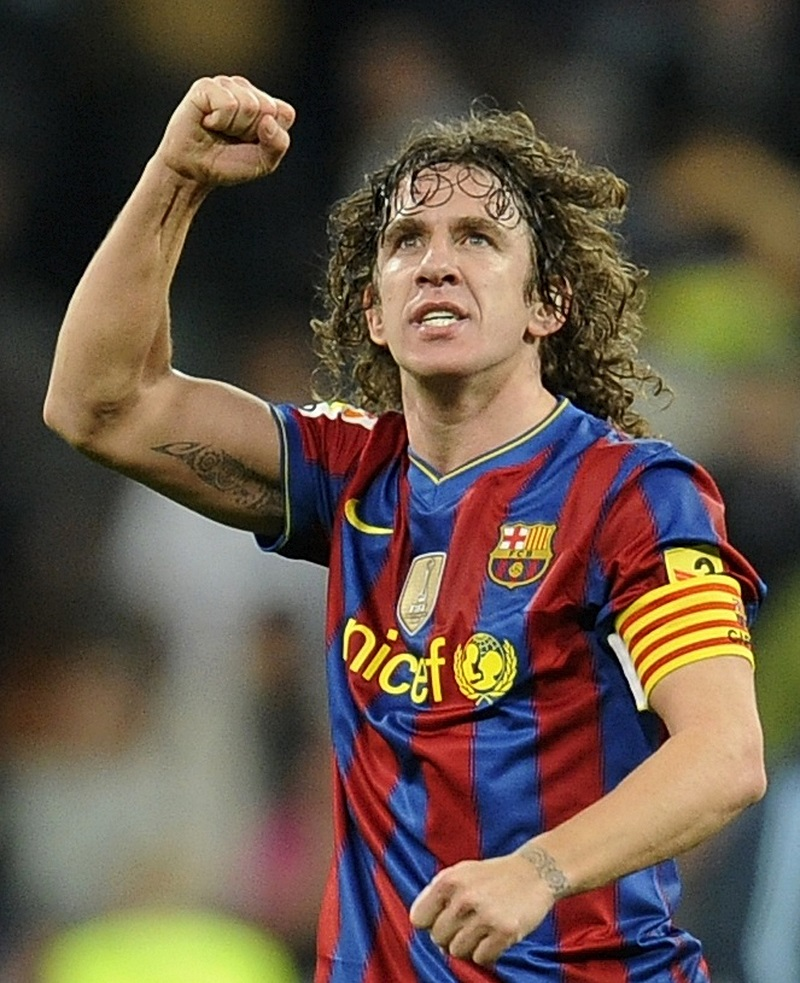 Barcelona's captain Puyol celebrates after their Spanish first division soccer match against Real Madrid in Madrid